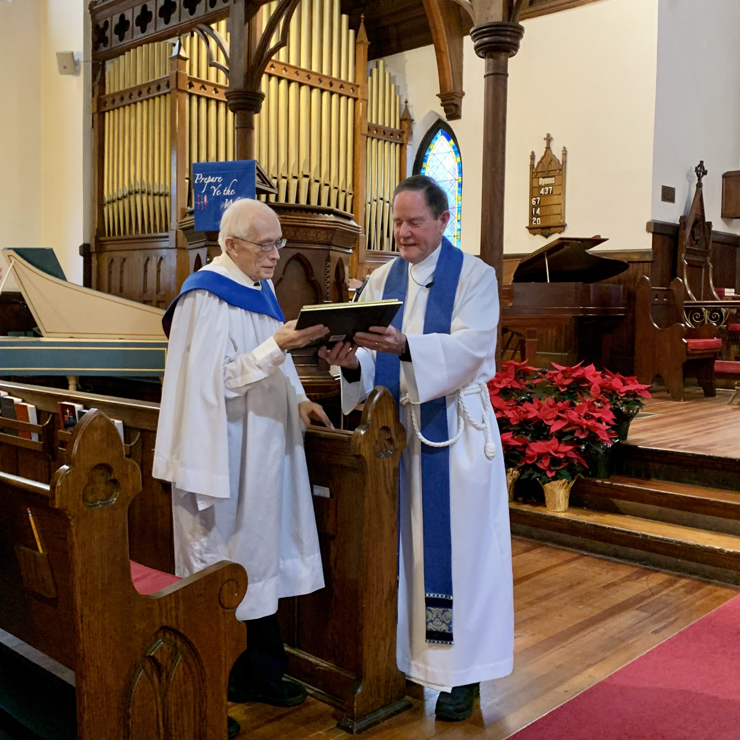 Rector Jerry Prickett recognizes Ron Lambe for his decades of service to St. Matthias.